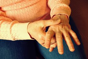 elderly hands with joint pain