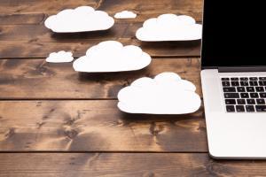 cloud symbol next to laptop